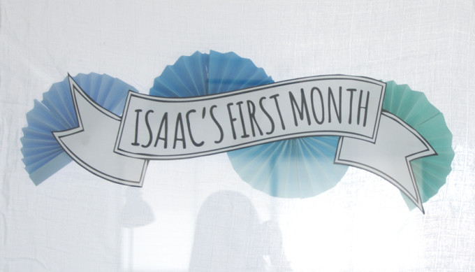 first month party sign on glass door